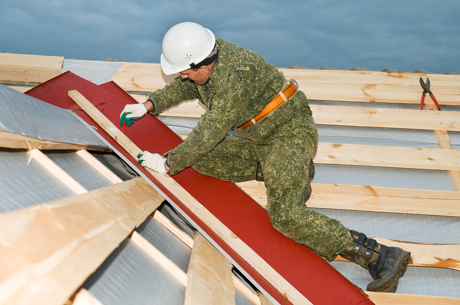 Worker At Roofing Works